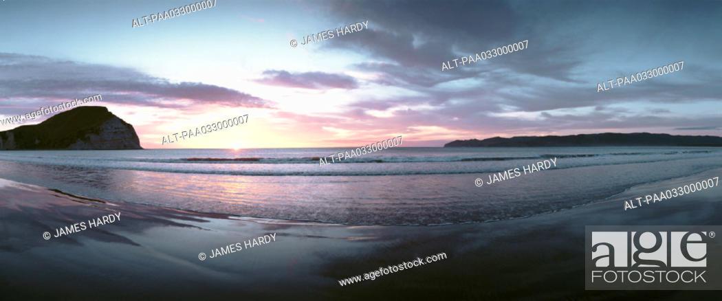 Stock Photo: New Zealand, beach at sunset, panoramic view.