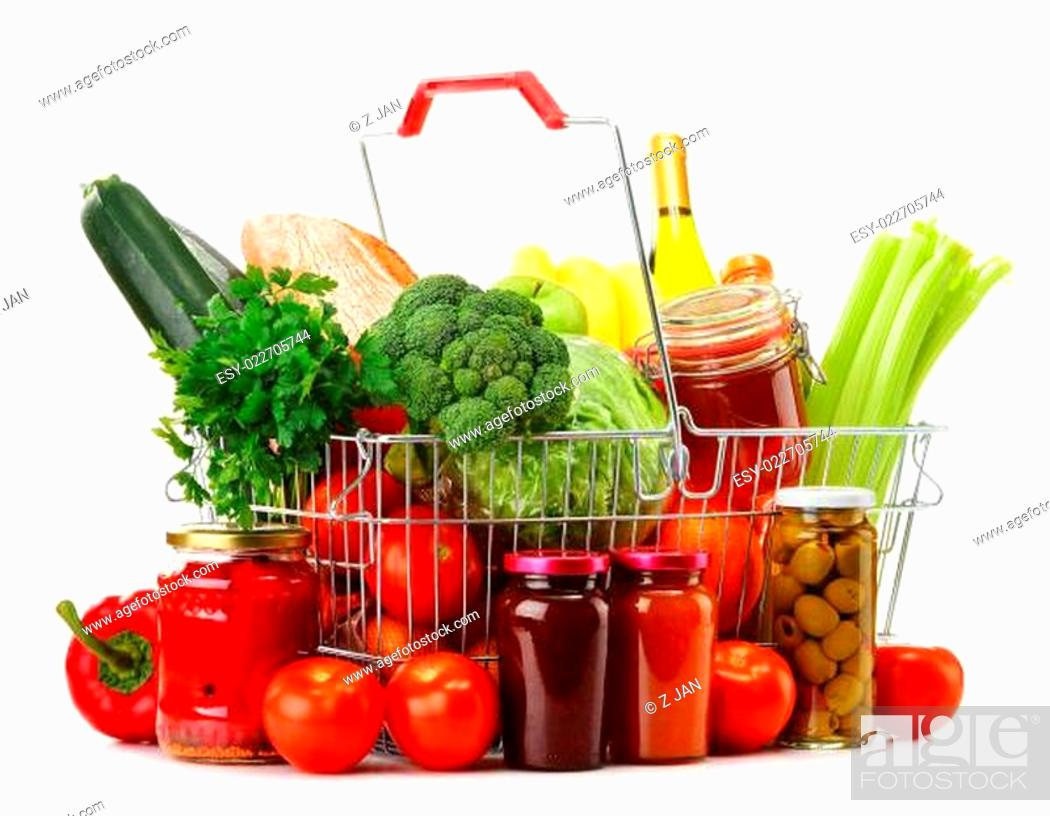 Stock Photo: Wire shopping basket with groceries isolated on white.