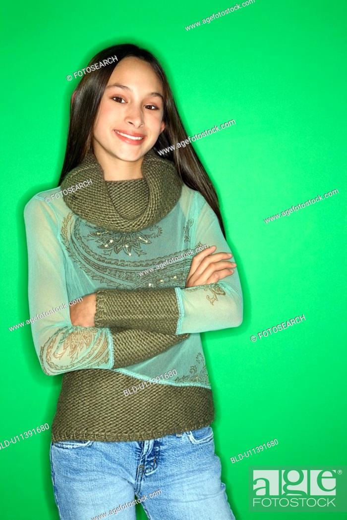 Stock Photo: Girl with arms crossed standing.