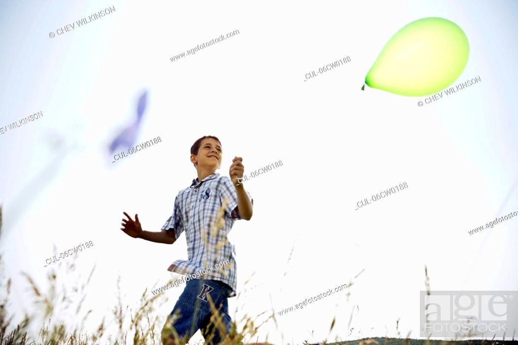 Stock Photo: Boy running with balloon.