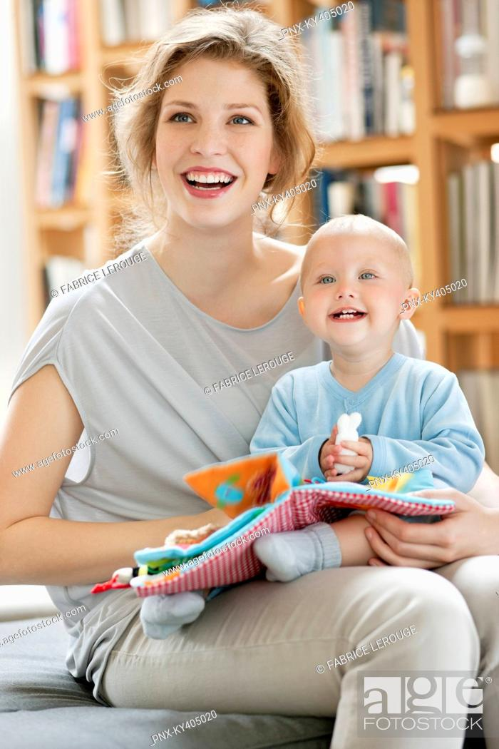 Stock Photo: Woman laughing with her baby girl.