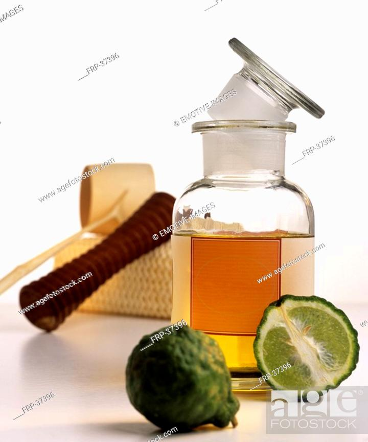 Stock Photo: Bergamot oil with kaffir lime, massage roller.