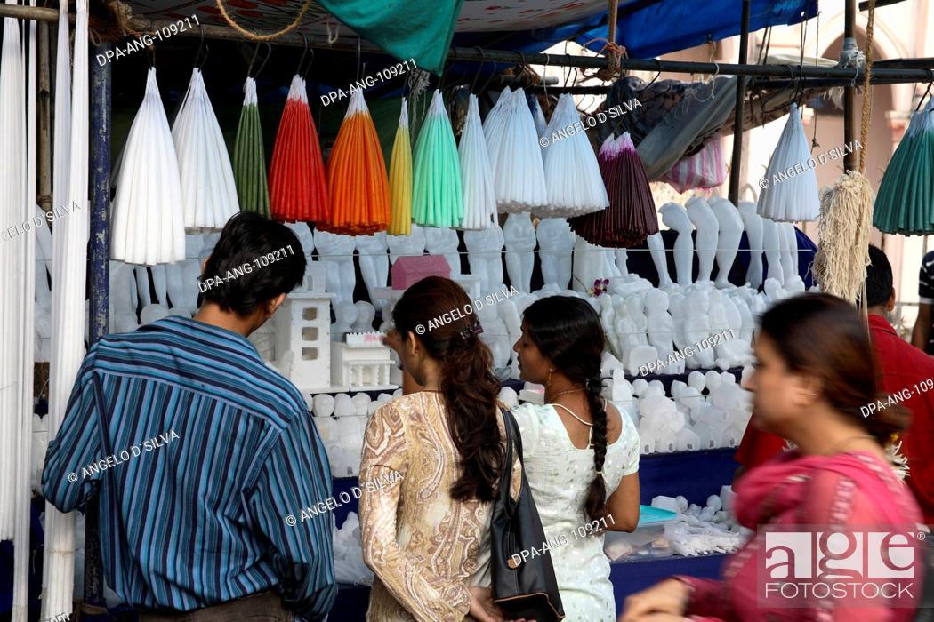 Stock Photo: devotees outside Mount Mary Church ; Mount Mary Festival ; Bandra Fair ; Bombay  Mumbai ; Maharashtra ; India NO MR;NO PR.
