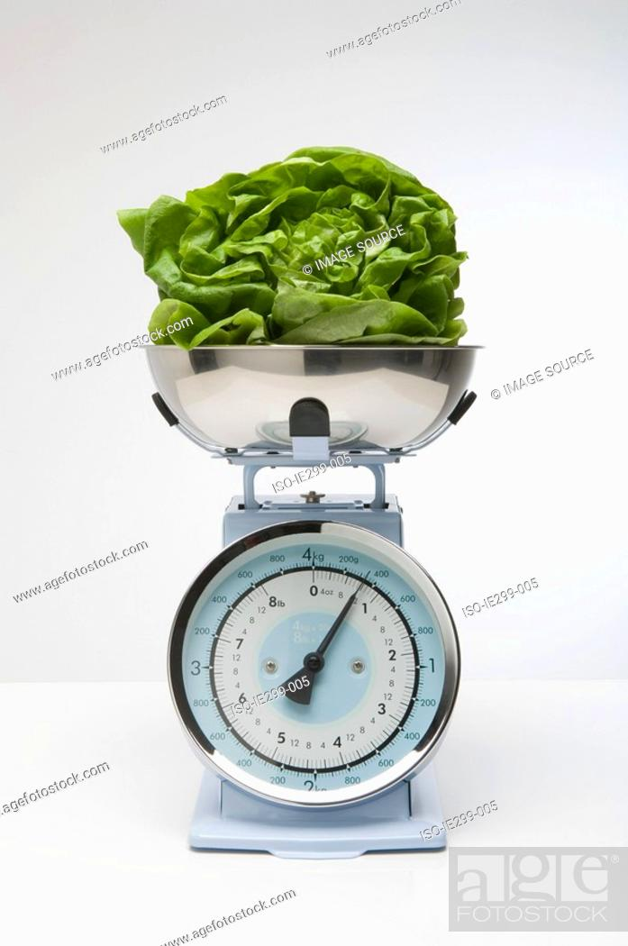 Stock Photo: Lettuce on kitchen scales.
