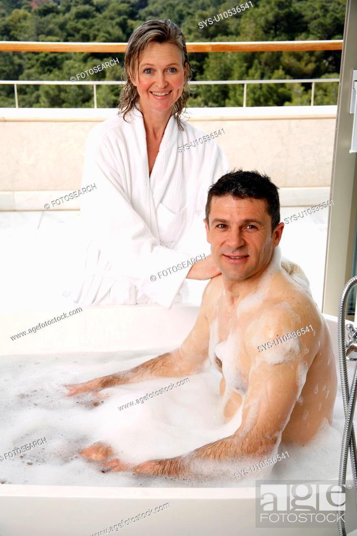 Stock Photo: Mature couple having fun in the bathtub.
