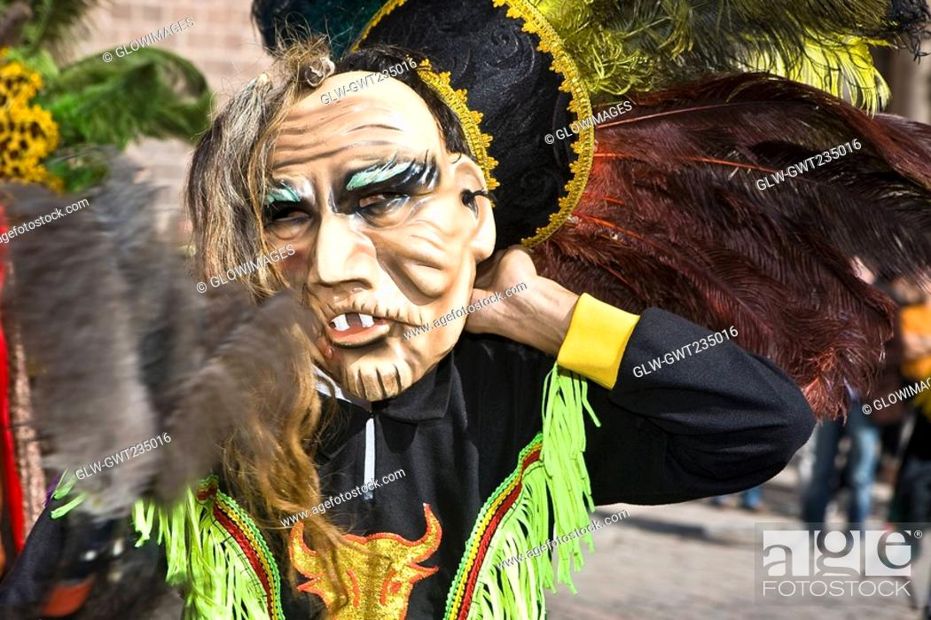 Stock Photo: Close-up of a person wearing a traditional costume on a festival, Peru.