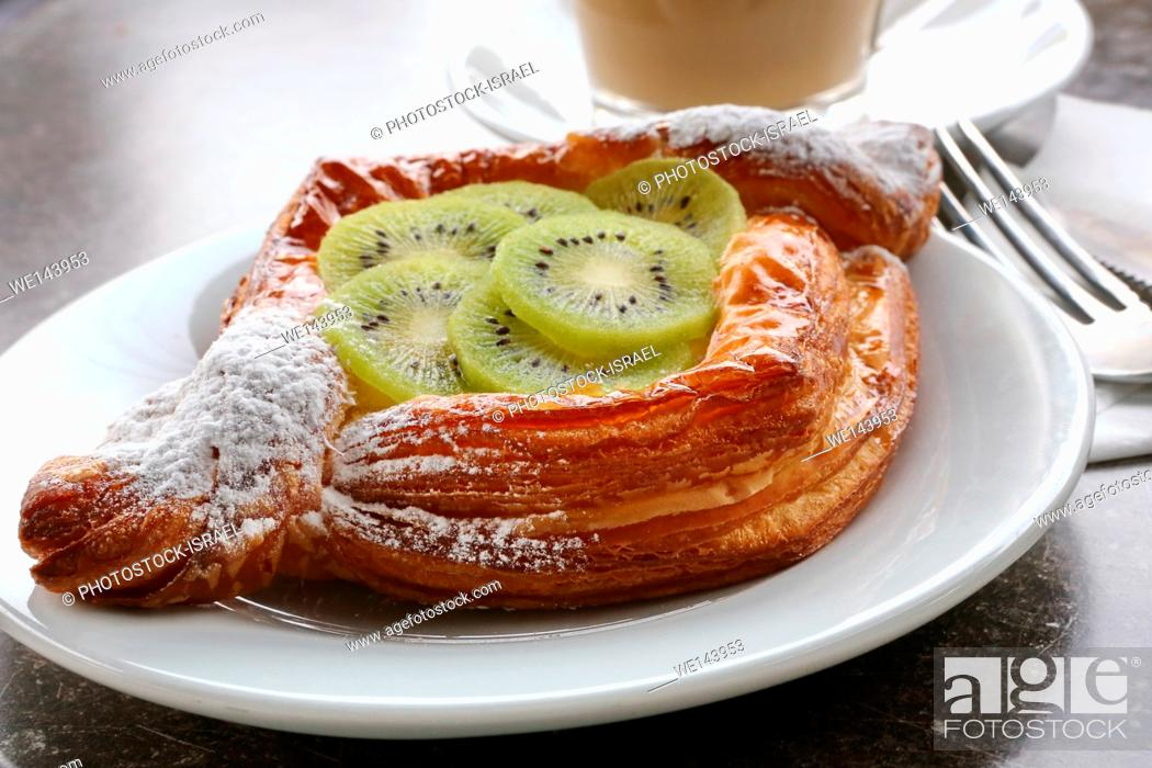 Stock Photo: Cheese and Kiwi Puff pastry or breakfast pastry in a bakery shop.