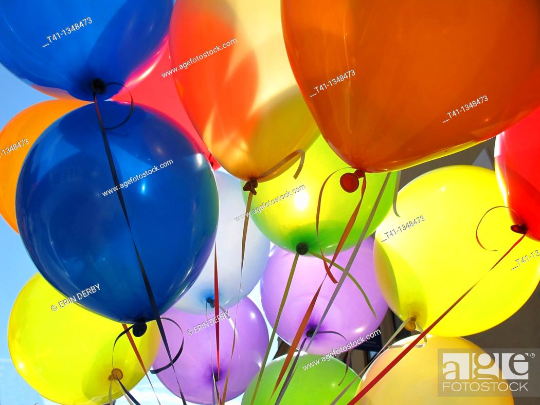 Stock Photo: A bunch of colorful birthday balloons.