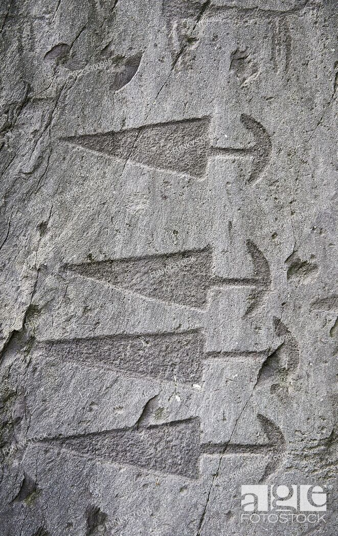Stock Photo: Prehistoric petroglyphs, rock carvings, in an ancient snctuary carved by the the ancient Camuni people in the Copper Age around the 3rd milleneum BC.