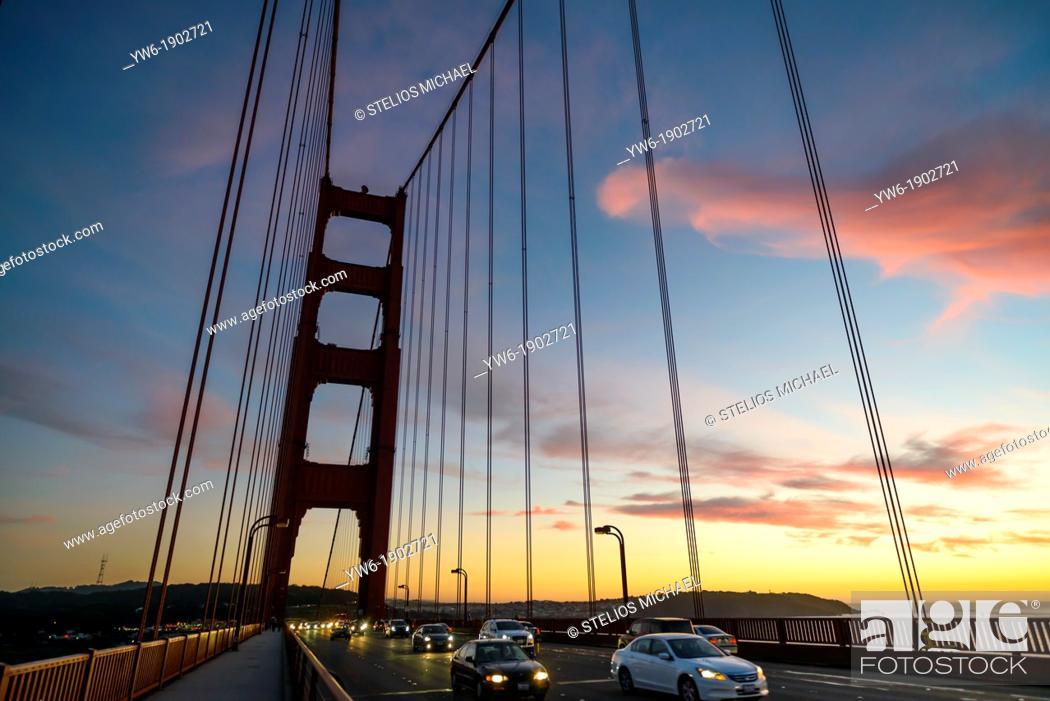 Stock Photo: Crossing the Golden Gate Bridge at sunset, San Francisco, California, USA.
