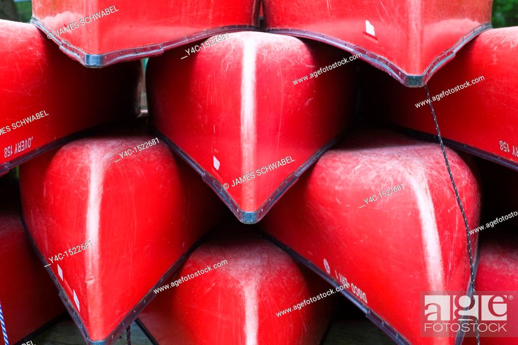 Stock Photo: Red canoes in Old Forge in the Adirondack Mountains of New York.