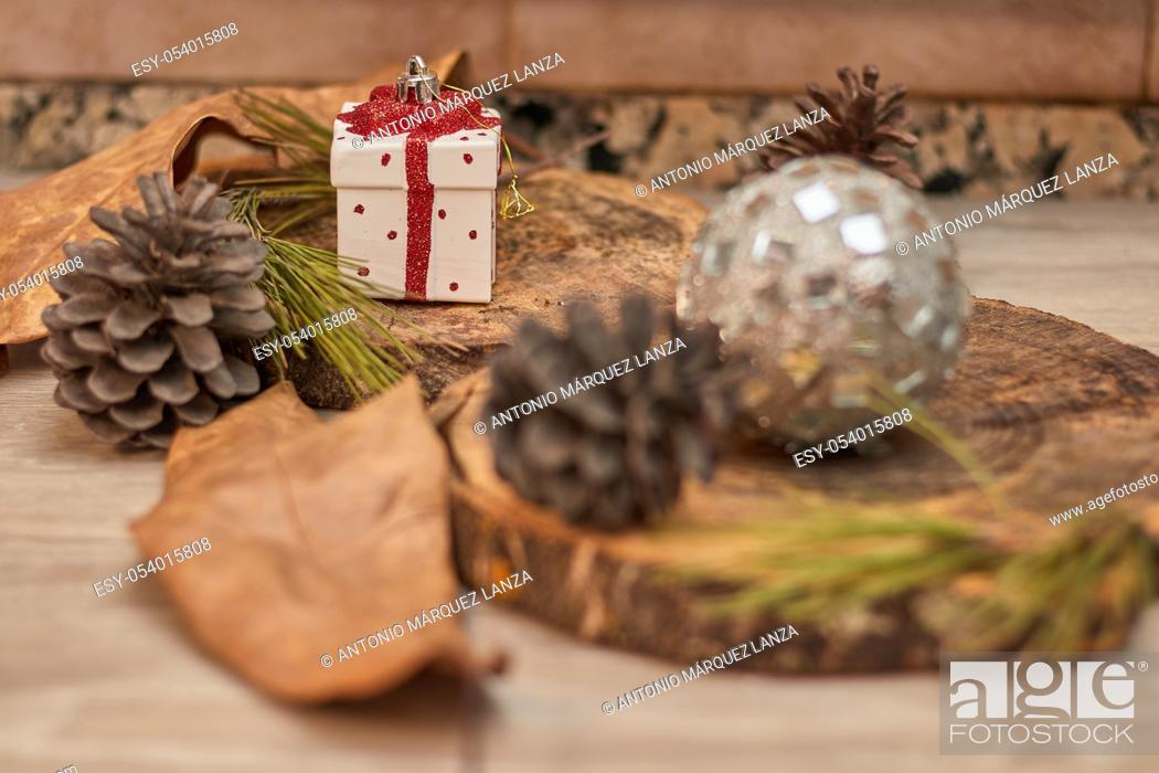 Stock Photo: christmas ornaments over wood, gifts.