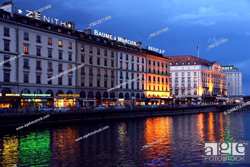 Stock Photo: night urban landscape of Geneva, buildings along Rhone river, Geneva, Switzerland.