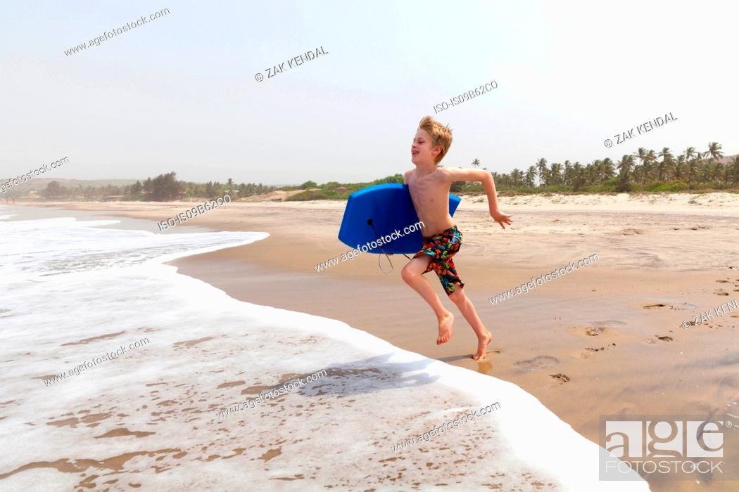 Stock Photo: Boy running on beach, Goa, India, Asia.
