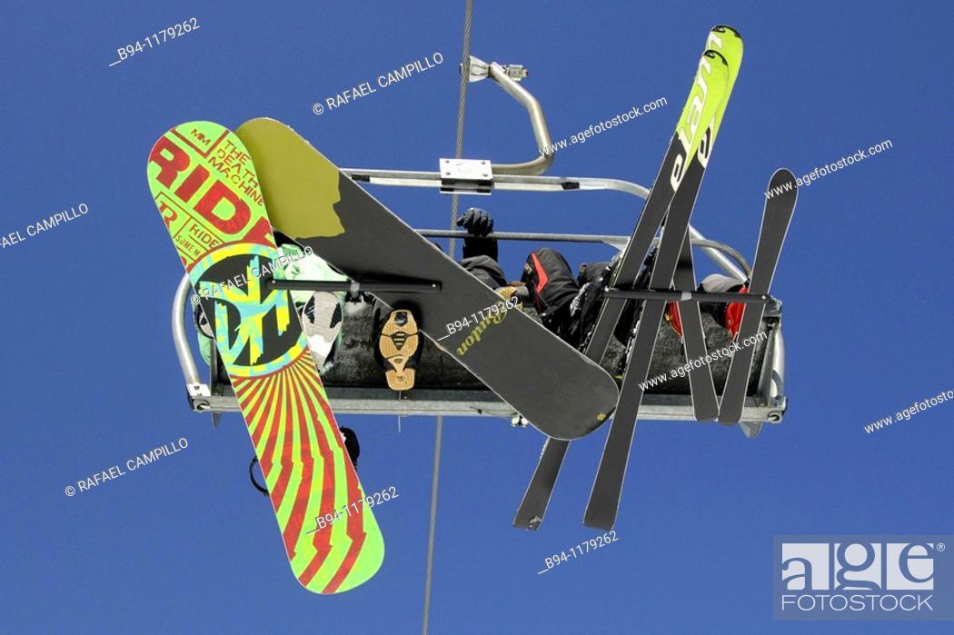 Stock Photo: Skiers on chairlifts. La Molina ski resort, Girona province, Catalonia, Spain.
