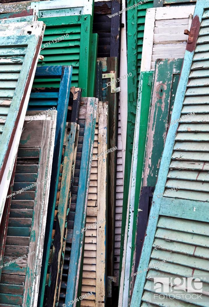 Stock Photo: Reclaimed shutters and doors at a salvage yard.