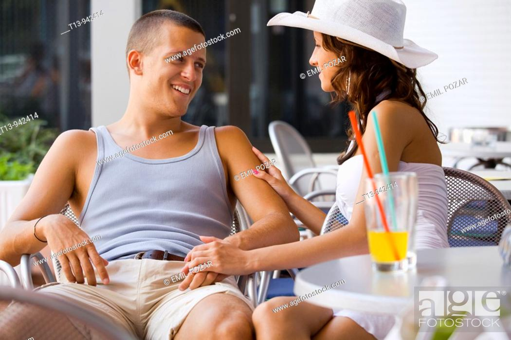Stock Photo: Young couple happy alone in bar.
