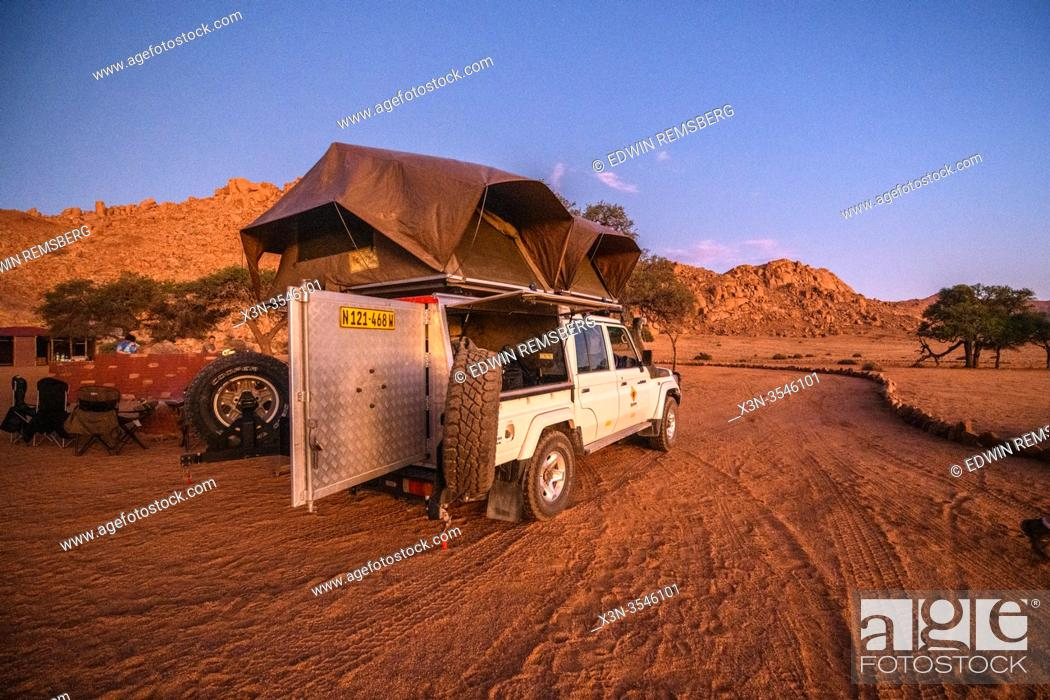 Stock Photo: A tent set up on a jeep for camping in the great outdoors , Helmeringhausen, Namibia.