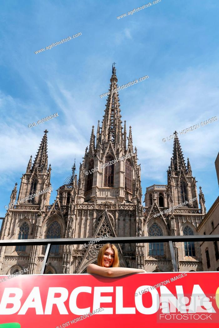 Imagen: Woman on open top bus in front of Barcelona Cathedral, Barcelona, Catalonia, Spain, Europe.