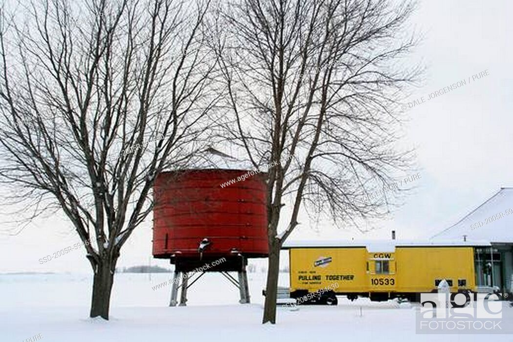 Stock Photo: Train and old water tank in winter, Minnesota, USA.