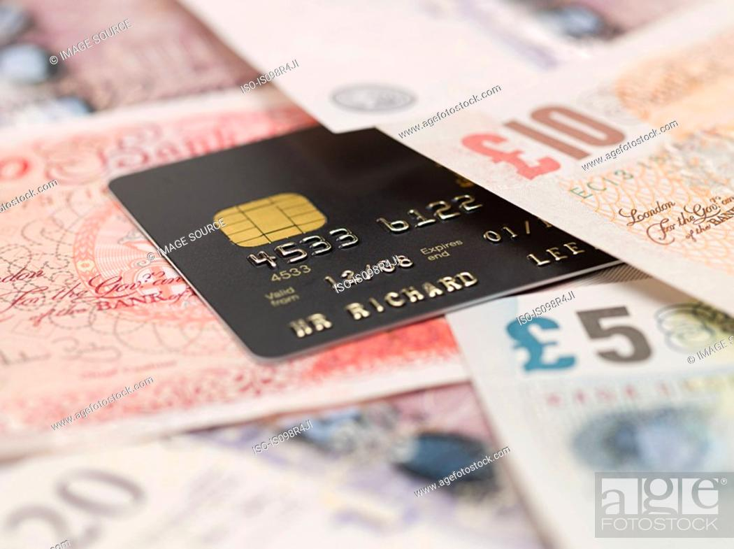 Stock Photo: Credit card and banknotes.