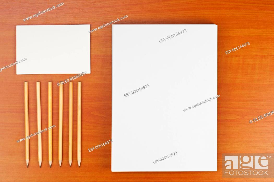 Stock Photo: Corporate ID set on wood background for presentations and portfolios.