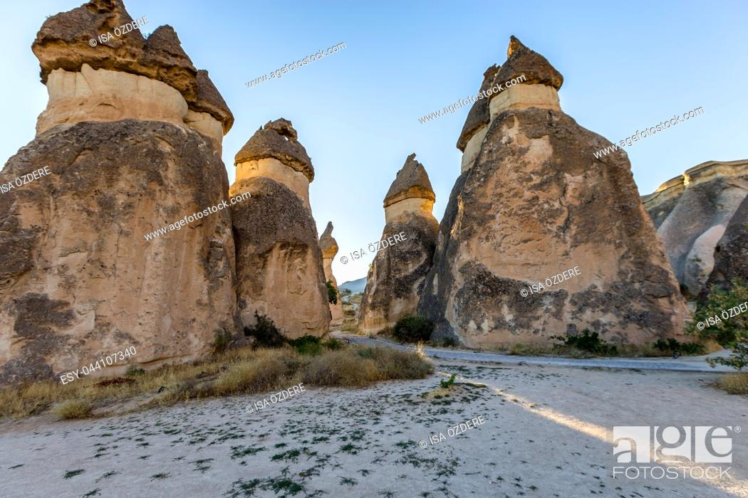 Stock Photo: Fairy tale chimneys in Cappadocia, tourist attraction places to fly with hot air balloons. Goreme, Cappadocia, Turkey.