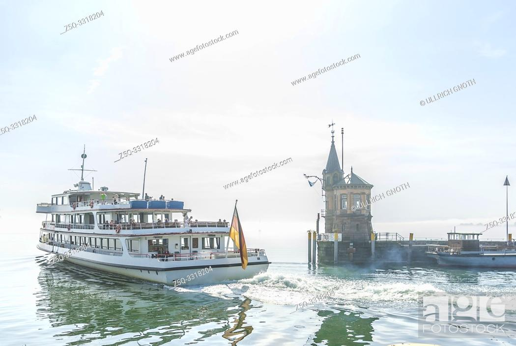 Stock Photo: Konstanz, Baden-Wurttemberg, Germany, Europe: A passenger ship is leaving the harbour for Lake Constance in the morning mist.