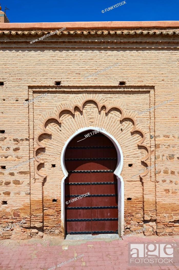 Stock Photo: Arabesque doorway to the Koutoubia Mosque completed 1199 with a square Berber minaret, Marrakesh, Morroco.