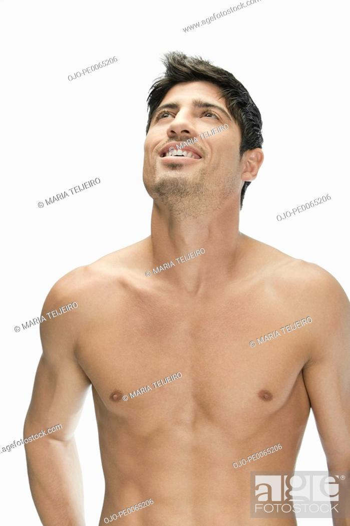 Stock Photo: Bare chested man looking up.