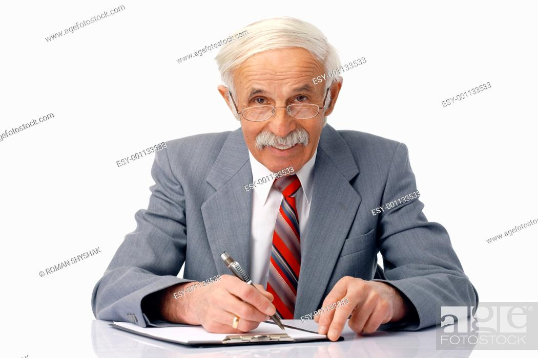 Stock Photo: Portrait of an elder smiling man writing something and looking at you.