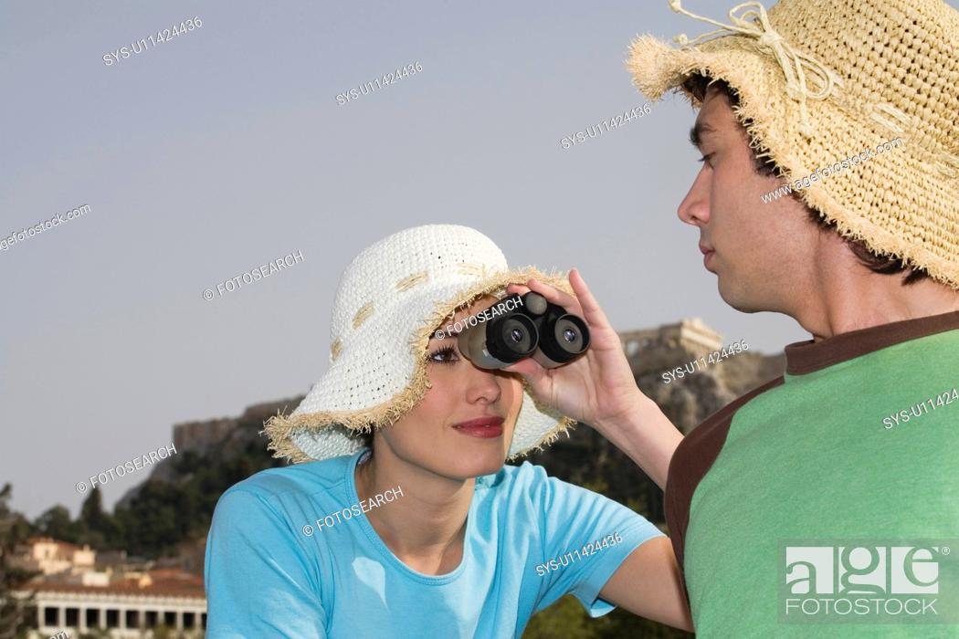Stock Photo: Couple at archaeological site with hats and binoculars.