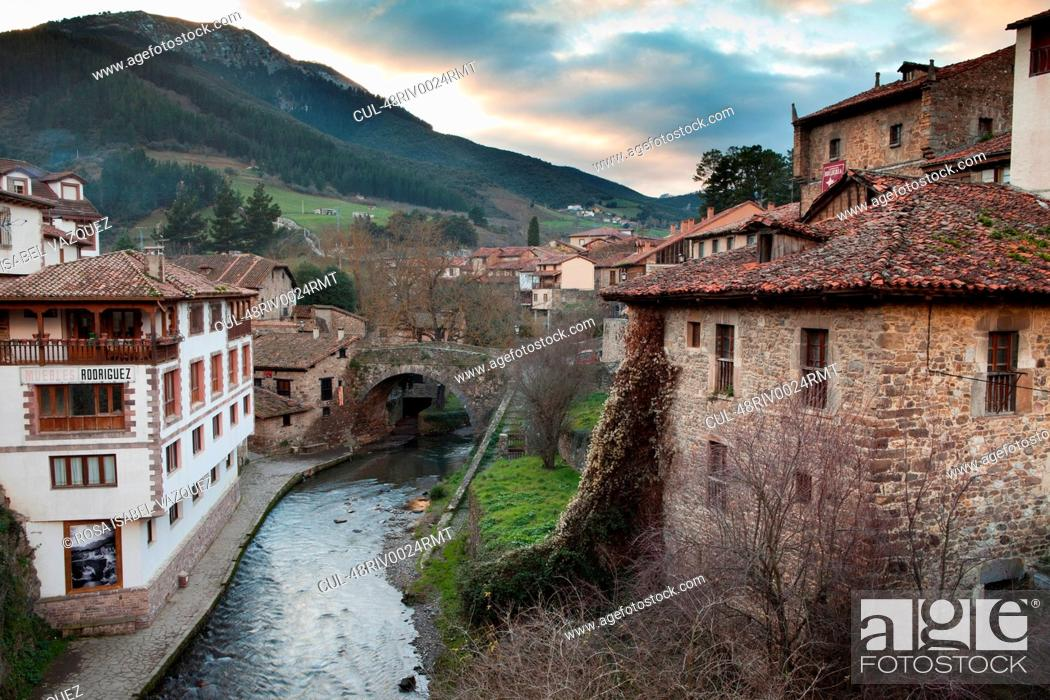 Stock Photo: Rural village buildings and canal.
