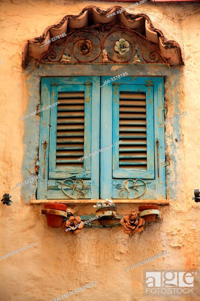 Stock Photo: Curious window in Manarola housing. Cinque Terre.