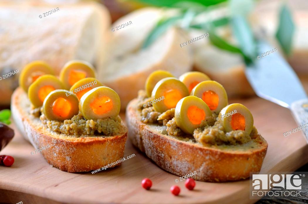Stock Photo: Baguette with olive paste.
