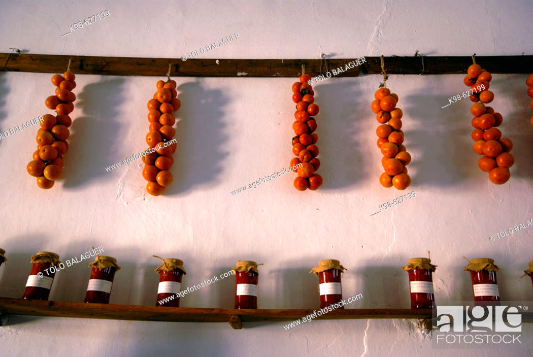 Stock Photo: Tomatoes and preserved tomatoes. Finca de Es Calderers (a.1700). Comarca de Es Pla. Sant Joan. Mallorca. Baleares. Spain.