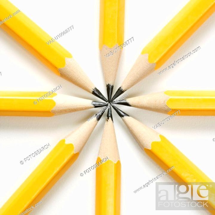Stock Photo: Sharp pencils arranged in a symmetrical radial star shape.