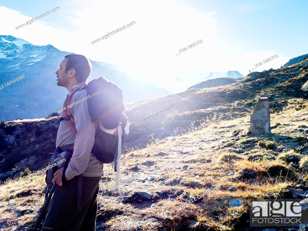Stock Photo: man during a trek in the Forni Valley, Valtellina, valfurva, Lombardy, Italy.