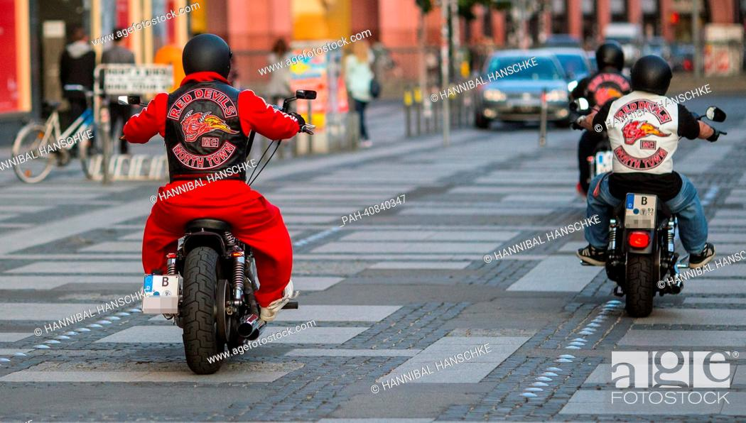 Stock Photo: Bikers of biker club 'Red Devils' drive their motorcycles on Alexanderplatz in Berlin, Germany, 02 July 2013. The 'Red Devils' are considered supporters of.