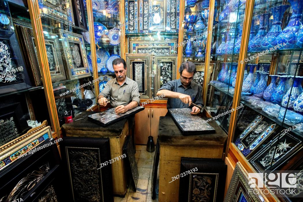 Stock Photo: Artists emboss ghalamzani silver pieces, ghalamzani means art of embossing patterns on different metals such as copper, silver, gold, and brass, Esfahan, Iran.