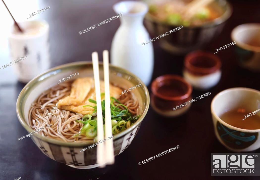 Stock Photo: Bowl of Ramen with Soba noodles and tofu on a table in a Japanese restaurant, Kyoto, Japan.