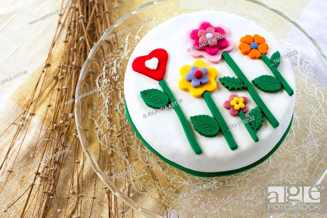 Stock Photo: Birthday cake with sugar flowers.
