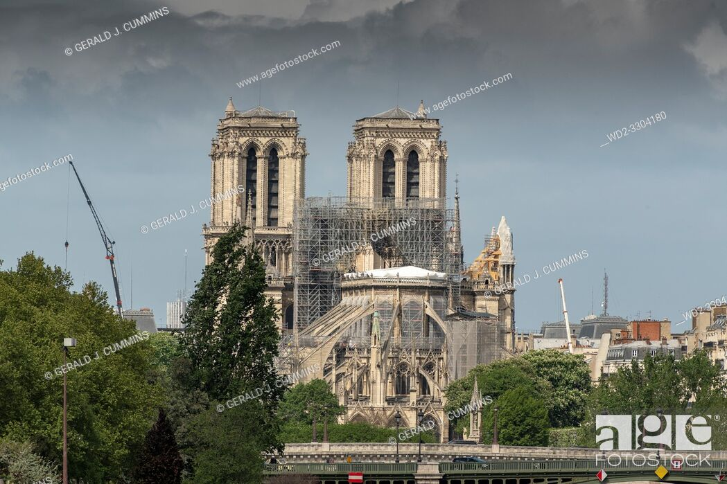 Stock Photo: PARIS, FRANCE - 19 APRIL 2019 Notre Dame cathedral, after the timber roof caught fire. The melted scaffolding, constructed for the exact purpose of restoring.
