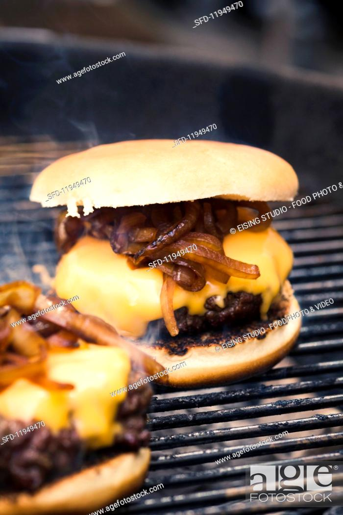Stock Photo: No People, Close-Up, Motion, Moving, Heat, Indoors, Interior, Near, Inside, Roll, Fire, Food, Meat, Dish, Cuisine, Action, Prepared, Smoke, Grilled, Nutrition, Melt, Melting, Photo, Make, Rack, Burger, Hamburger, Focus, Fried, Cheese