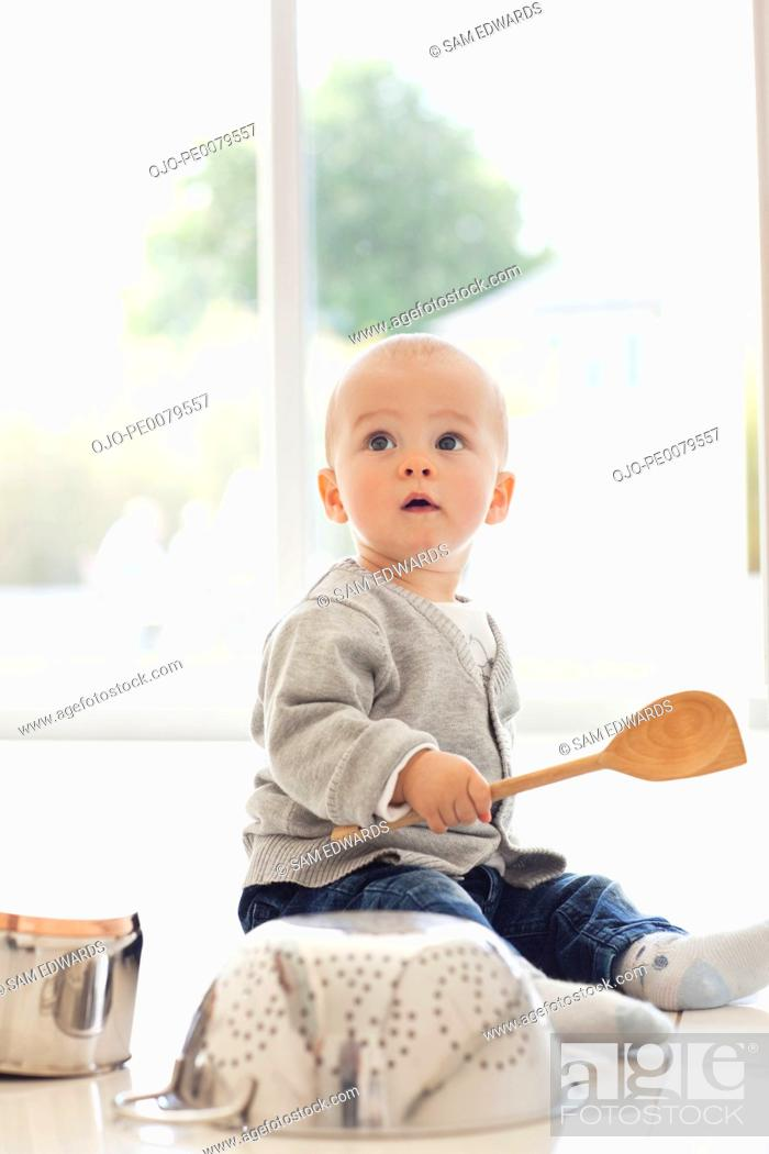 Stock Photo: Baby banging on pots and pans.