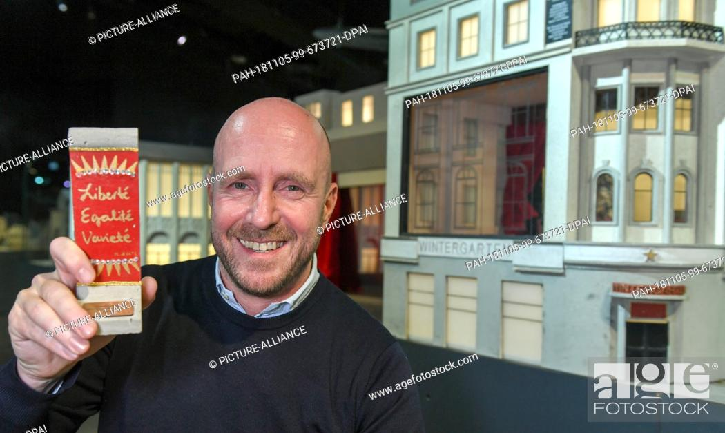 Stock Photo: 05 November 2018, Berlin: Thomas Eißler, theatre director Wintergarten Berlin, shows a wall element designed by himself on a scale of 1:21 at a press event in.