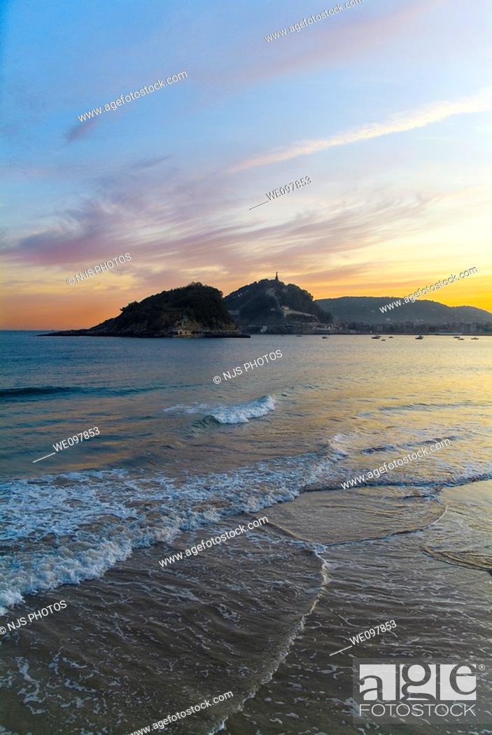 Stock Photo: Sunrise with the island of Santa Clara and Mount Urgull  View from the beach Ondarreta  San Sebastián, Guipúzcoa, Basque Country, Spain.