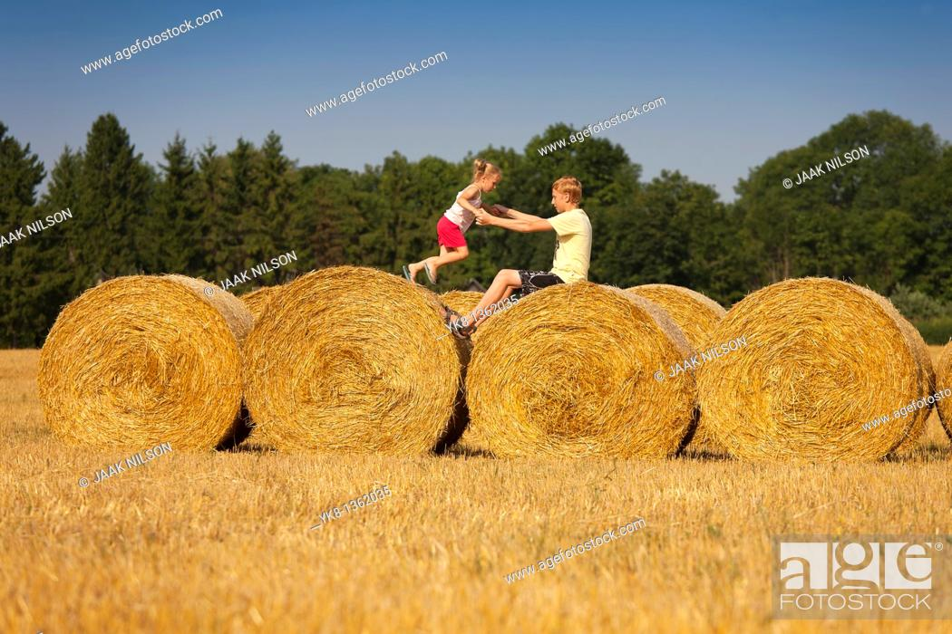 Stock Photo: Children Playing on Corn Bales, Estonia.