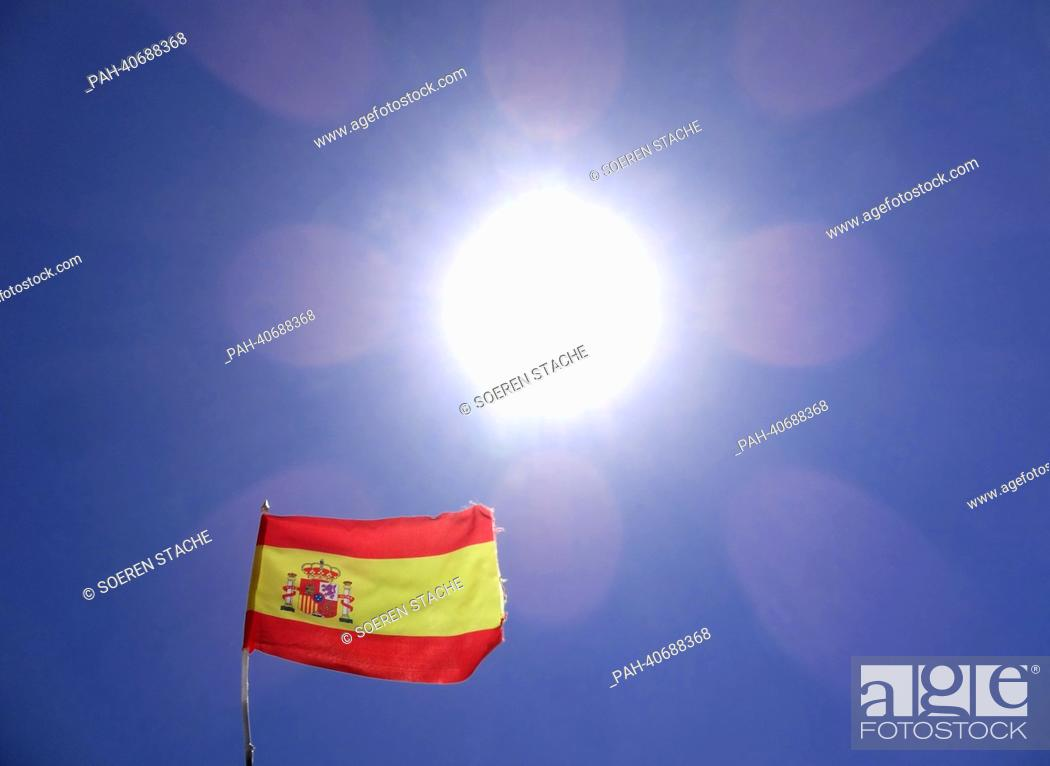 Stock Photo: The Spanish flag flies in front of the suns which shines from a cloudless sky at the Costa Calma on Fuerteventura, Spain, 05 June 2013.