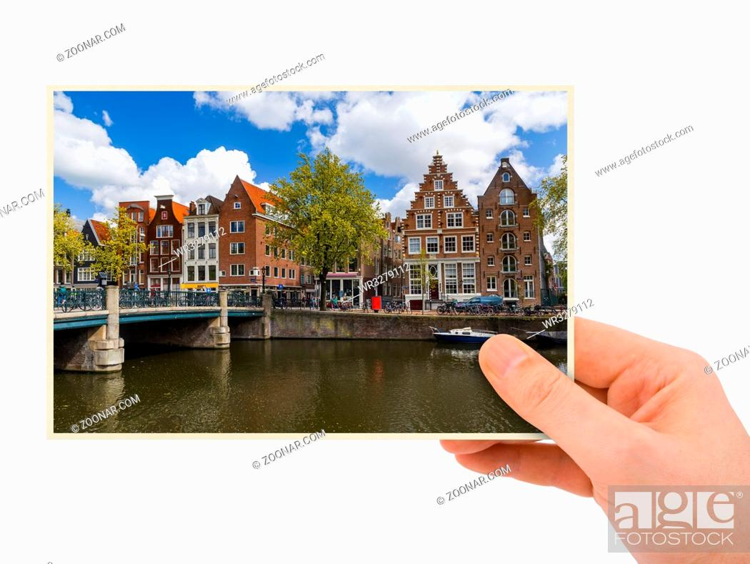 Photo de stock: Hand and Amsterdam cityscape - Netherlands (my photo) isolated on white background.